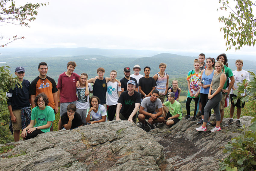 Group of dyslexic teens on top of mountain lookout