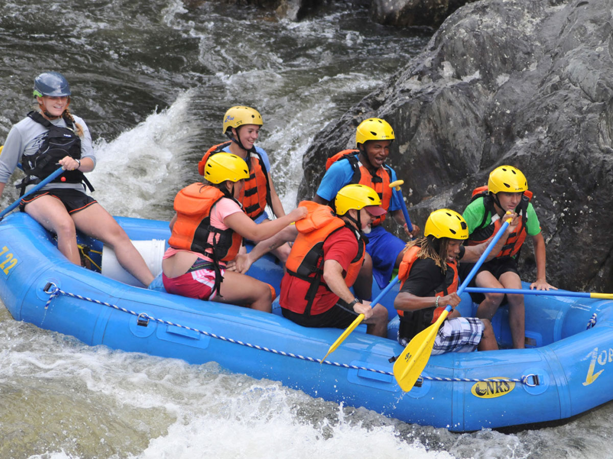 Group of dyslexic students rafting down rapids