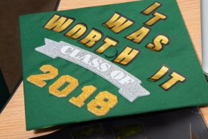 "Graduation cap with message ""It was worth it, class of 2018"""
