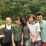 five teens posing for photo in costa rica