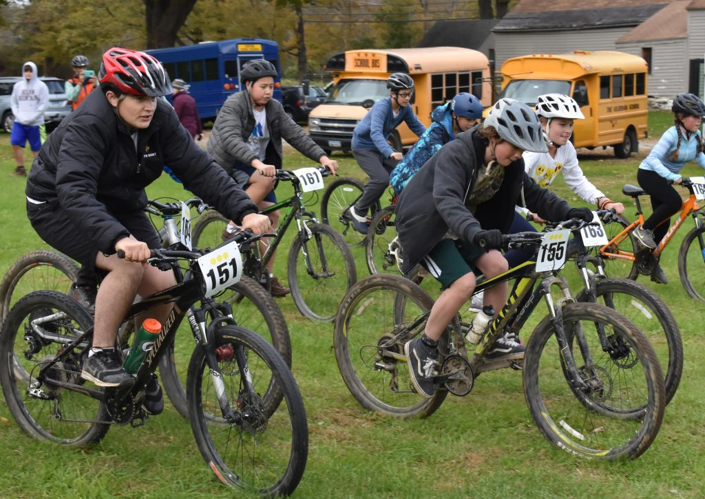 Mountain biking, student racing at the start pack.