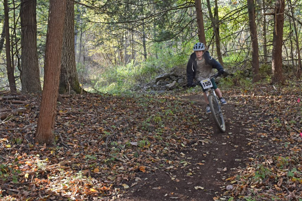 Kildonan Mountain biker in woods rounding corner.