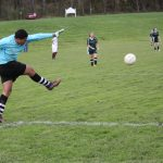 Kildonan soccer goalie punts the ball