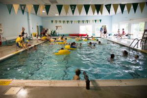 Camp Dunnabeck campers splash and swim