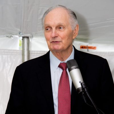 Alan Alda speaking at a podium at the Kildonan school graduation.